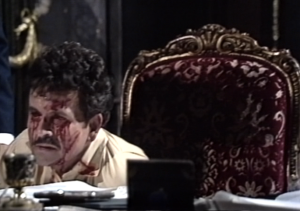 Oedipus, blinded, at desk (BBC, 1972)